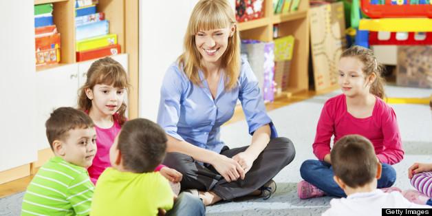 Teacher discussing with children.