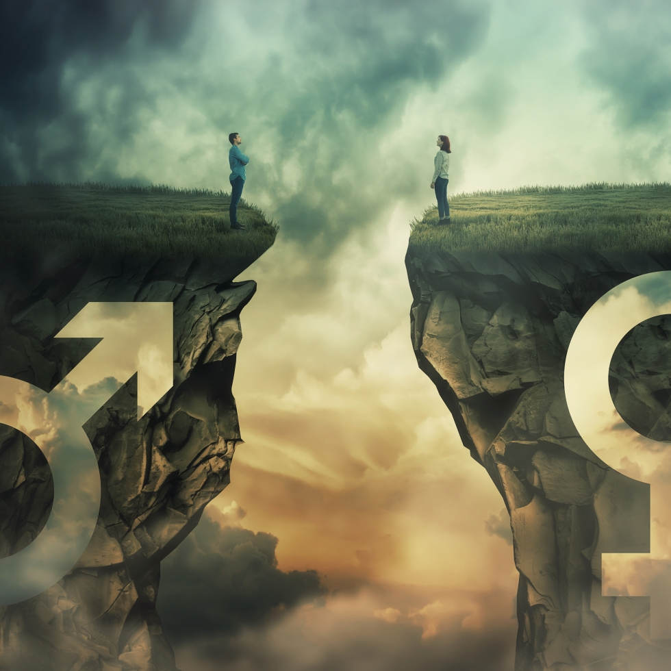 Mies ja nainen seivovat kalliojyrkänteillä, kuilu välissään.